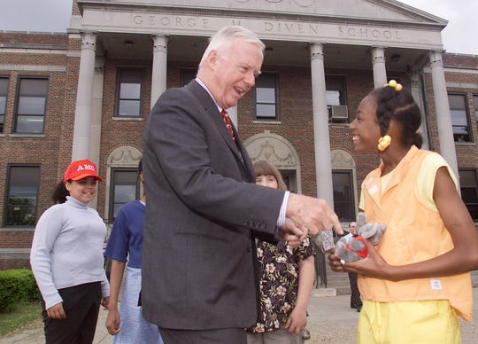 5/30/2001, 1C; 8/22/2004, 5A: U.S. Rep. Amo Houghton, R-Corning, is greeted Tuesday by fifth-grader Shanicqua Green of Elmira during a visit to Diven Elementary School. Green and her classmates will visit Houghton in his Washington office on June 8.