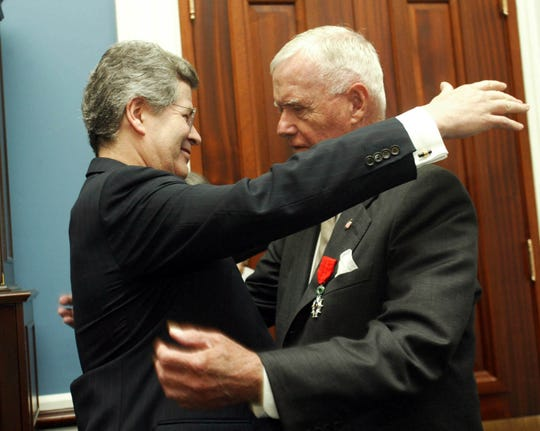 NY-HOUGHTON -- French Ambassador to the U.S. Jean-David Levitte, left, congratulates former Rep. Amo Houghton, R-N.Y., after presenting him with the French Legion of Honor award at the U.S. Capitol in Washington on Thursday, July 12, 2007. (Gannett News Service, Heather Wines)