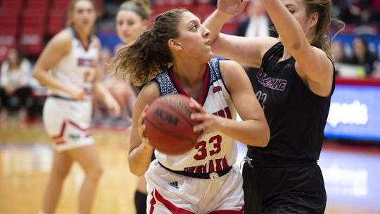 Hannah Haithcock goes up for a shot in USI's opening game of the GLVC tournament against Bellarmine on Thursday. The Screaming Eagles were eliminated by the Knights, 66-59.