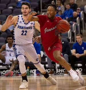 Jacksonville State's Derek St. Hilaire (15) drives the baseline against Eastern Illinois's Josiah Wallace (22) during their quarterfinal game of the Ohio Valley Conference Basketball Championships at Ford Center in Evansville, Ind., Wednesday night, March 4, 2020.