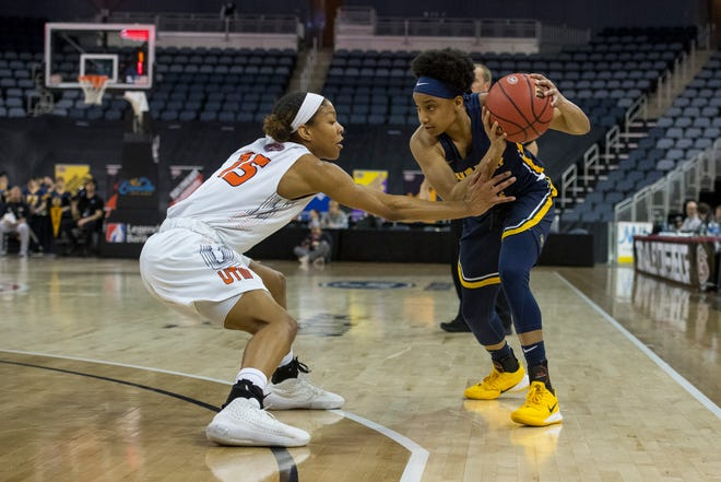 Murray State's Ashley Hunter (with ball) faces UT Martin's Brittni Moore in the first round of the Ohio Valley Conference women's basketball tourney on March 4 at Ford Center. Hunter has transferred to USI.