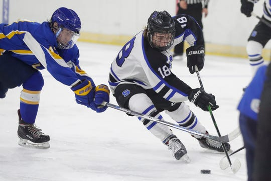Saint Mary's Springs' Noah Pickart (18) skates through the Rice Lake defense during a WIAA Division 2 state semifinal Thursday at Alliant Energy Center in Madison.