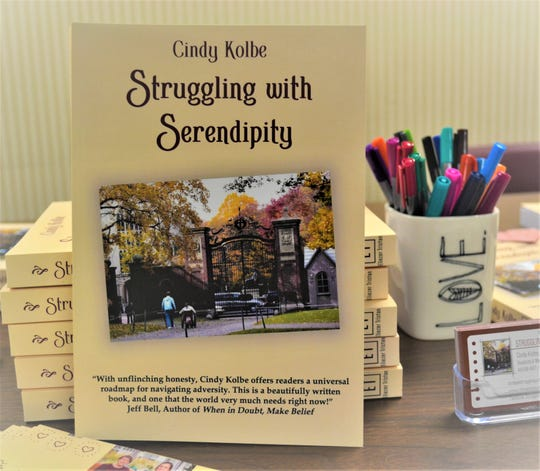 """""""Struggling with Serendipity"""" tells the story of Cindy Kolbe's life after a tragic accident left her 14-year-old daughter paralyzed. Kolbe travels around the country sharing her story of hope and teaching others how to tell their stories. She will be teaching a writing workshop in Tiffin in June."""