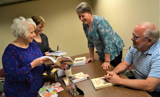 """Cindy and John Kolbe, on the right, traveled to Fremont from their home in West Virginia, to host an Author Talk and Signing at Birchard Public Library on March 2. Here, they talk about Cindy's book, """"Struggling with Serendipity,"""" with Dianne Hopfer of Toledo, left, and Roxanne Esterline of Sylvania."""