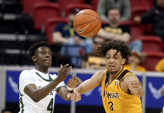 Colorado State's Isaiah Stevens (4) and Wyoming's Kwane Marble II (3) reach for a loose ball during the first half of a Mountain West Conference tournament NCAA college basketball game Wednesday, March 4, 2020, in Las Vegas.