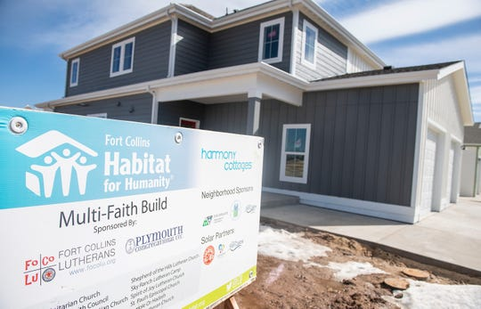 Construction continues in Harmony Cottages in Fort Collins, Colo. on Wednesday, March 4, 2020. Habitat for Humanity is building Harmony Cottages, a neighborhood for lower-income residents at the corner of Harmony Road and Taft Hill as the city of Fort Collins again considers inclusionary zoning that would require every development to include affordable housing.