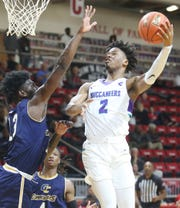 Ralph Bissainthe goes to the basket against Gulf Coast's Derrick Hardin during their FCSAA men's quarterfinal game in Niceville.