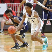 FSW's Jalen Finch steals the ball against Gulf Coast State during their FCSAA men's quarterfinal game in Niceville.