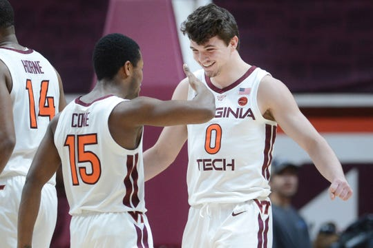 Mar 4, 2020; Blacksburg, Virginia, USA; Virginia Tech Hokies guard Hunter Cattoor (0) high fives guard Jalen Cone (15) during a timeout against the Clemson Tigers in the second half at Cassell Coliseum. Mandatory Credit: Michael Thomas Shroyer-USA TODAY Sports