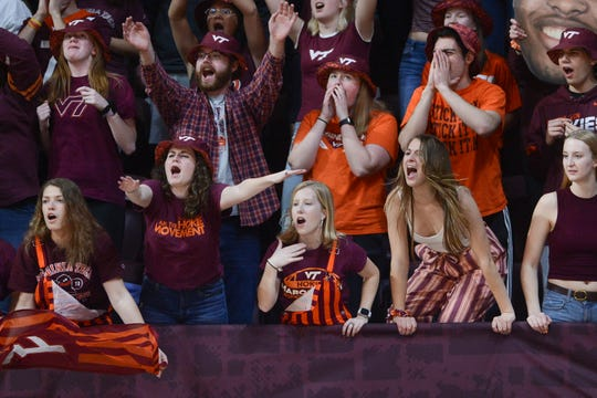 Mar 4, 2020; Blacksburg, Virginia, USA; Virginia Tech Hokies fans cheer during the second half against the Clemson Tigers at Cassell Coliseum. Mandatory Credit: Michael Thomas Shroyer-USA TODAY Sports
