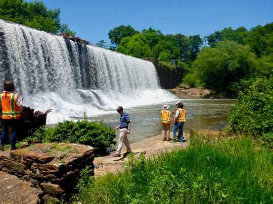 DHEC employees inspect the Lake Conestee dam.