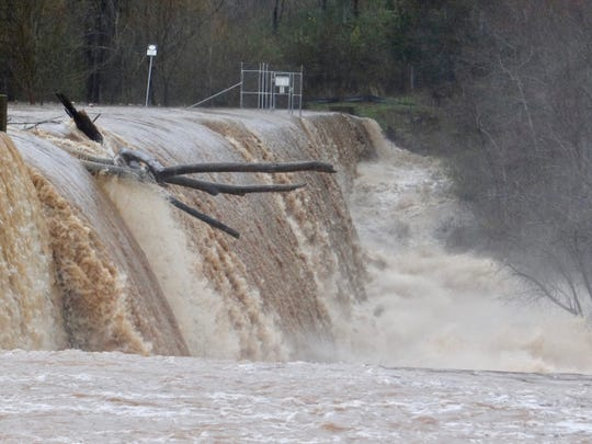 Woody debris in the Lake Conestee dam during heavy rainfall and flooding in Greenville County on Feb. 6, 2020.