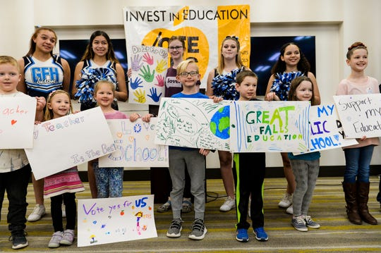 Students from Great Falls Public Schools hold up signs urging support of public schools during a rally for the Great Falls Public Schools' 2020 operational levy that will be on the ballot in May.