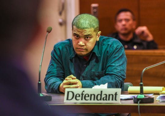 Defendant Brandon Acosta listens to comments made by the prosecutor during his murder trial at the Superior Court of Guam on March 5, 2020.