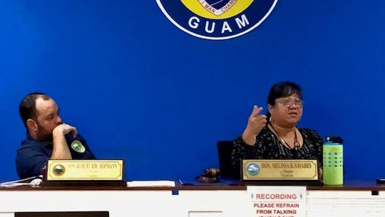 Mayors' Council of Guam President and Dededo Mayor Melissa Savares addresses mayors during a March 4, 2020 meeting, while vice president and Sinajana Mayor Robert Hofmann looks on.