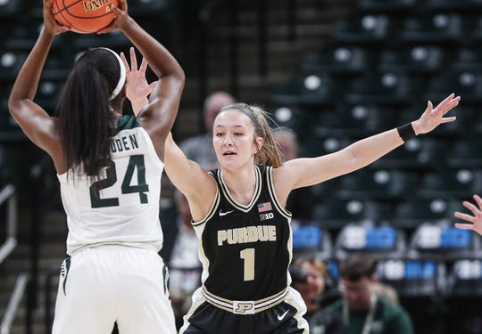 Purdue Boilermakers guard Karissa McLaughlin (1) guards Michigan State Spartans guard Nia Clouden (24) during the Big Ten women's basketball tournament at Bankers Life Fieldhouse, Indianapolis, Thursday, March 5, 2020. Purdue Boilermakers defeated Michigan State Spartans, 72-63.