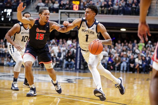 Butler forward Jordan Tucker (1) drives on St. John's forward Damien Sears (15) during the first half of an NCAA college basketball game in Indianapolis, Wednesday, March 4, 2020.
