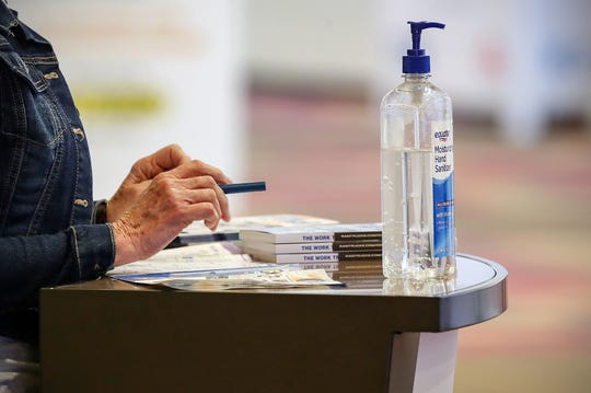 Hand sanitizer sits at an information booth during the 2020 Work Truck Show at the Indiana Convention Center in Indianapolis on Thursday, March 5, 2020.