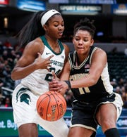 Purdue Boilermakers guard Dominique Oden (11) knocks the ball out of Michigan State Spartans guard Nia Clouden (24) hands during the Big Ten women's basketball tournament at Bankers Life Fieldhouse, Indianapolis, Thursday, March 5, 2020.