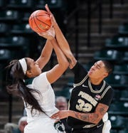 Purdue Boilermakers forward Ae'Rianna Harris (32) blocks a shot from Michigan State Spartans forward Taiyier Parks (14) during the Big Ten women's basketball tournament at Bankers Life Fieldhouse, Indianapolis, Thursday, March 5, 2020.