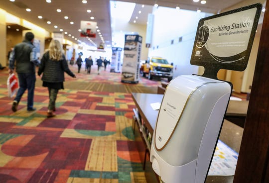 A hand-sanitizing station sits along a main corridor at the Indiana Convention Center in Indianapolis on Thursday, March 5, 2020.