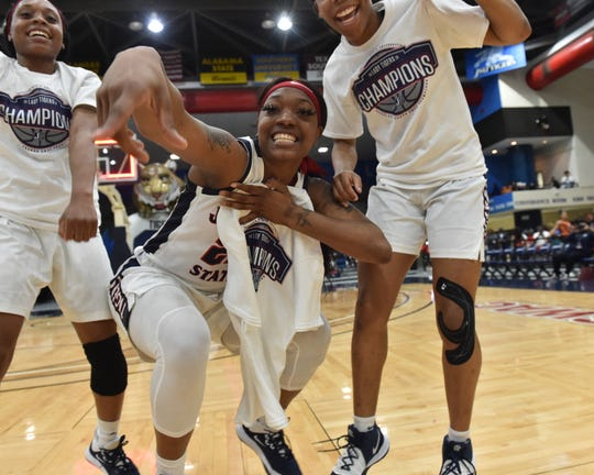 Players from the Jackson State University women's basketball team celebrate following their win of the South Western Athletic Conference title against Arkansas Pine-Bluff, 68-47, on Monday at JSU in Jackson. For the first time since 2007, the women's basketball team had won the Southwestern Athletic Conference regular-season championship. Monday, March 2, 2020.