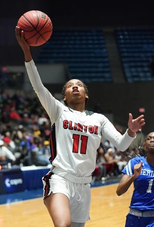 Kimbreyelle McBride (11) Clinton drives for a layup during the MHSAA 6A girls basketball semifinals March 4 at the Mississippi Coliseum