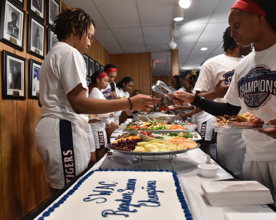 Players from the Jackson State University women's basketball team enjoy a celebratory meal following their win of the Southwestern Athletic Conference title against Arkansas Pine-Bluff, 68-47, on Monday at JSU in Jackson. For the first time since 2007, the women's basketball team had won the Southwestern Athletic Conference regular-season championship. Monday, March 2, 2020.