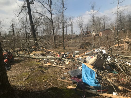 The downed trees show the tornado's path as it headed toward Carl Frazee's trailer, killing him as it picked the mobile home up and threw it across Bethel Church Road.