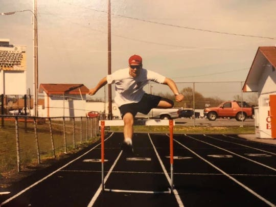 Scott Clark shows the form in 1996 that made him the Powell track team's decathlete.