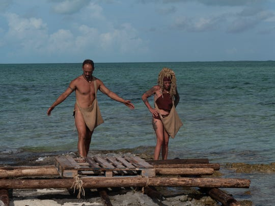 "Lisa Hagan, 48, of Lafayette takes on a 21-day challenge to survive on a string of islands in the Caribbean without provisions or clothing on an episode of ""Naked and Afraid"" that airs at 7 p.m. CT March 22 on the Discovery Channel. Here she works with her partner Joe on building a raft."