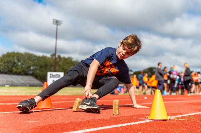Rylar Mahler competing as Teams of elementary students compete in the district fitness meet for a chance to represent Lafayette Parish at the state competition. Thursday, March 5, 2020.