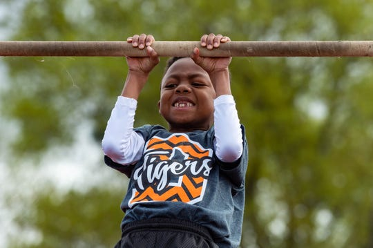 Jordan Davis, of Duson Elementary, does pull ups during the Lafayette Parish district fitness meet on Thursday, March 5, 2020. Teams of elementary students compete in the district meet for a chance to represent Lafayette Parish at the state competition.