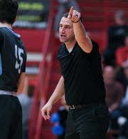Collins head coach Chris Gaither instructed his team against Henry County during their 8th Region Tournament game at Henry County High School in New Castle, Ky. on Mar. 3, 2020.