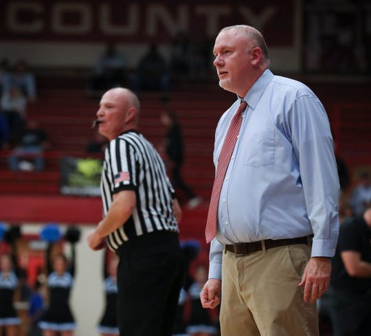 Henry County head coach Enoch Welch watched his team play Collins during their 8th Region Tournament game at Henry County High School in New Castle, Ky. on Mar. 3, 2020.