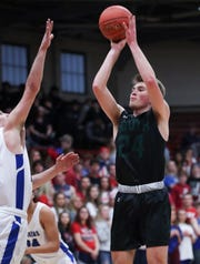 South Oldham's Luke Morrison (24) shot against Simon Kenton during their 8th Region Tournament game at Henry County High School in New Castle, Ky. on Mar. 3, 2020.