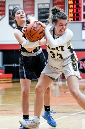 Holt's Karissa Cochran, right, and Okemos' Jacqueline Semerly battle for a rebound during the third quarter on Wednesday, March 4, 2020, at Jackson Northwest High School.