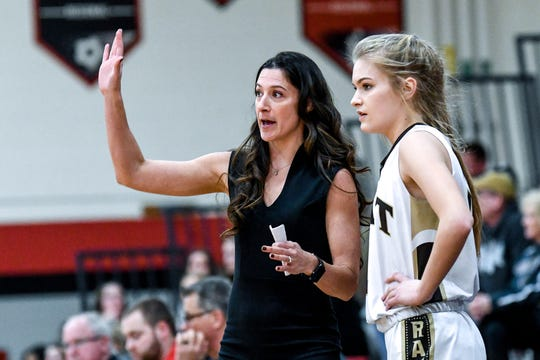 Holt's head coach Cassie Kotlarczyk, left, talks with Abigail Rutledge during the first quarter on Wednesday, March 4, 2020, at Jackson Northwest High School.