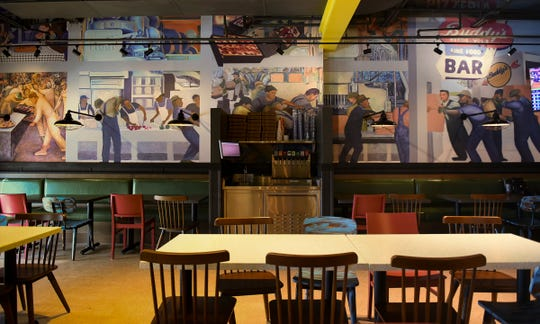 A mural inside Buddy's Pizza, slated to open March 19 on West Saginaw Highway in Delta Township.