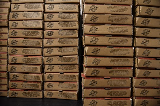 Pizza boxes at the ready inside Buddy's Pizza, slated to open March 19 on West Saginaw Highway in Delta Township.