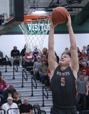 Shelby's TJ Pugh throws down a two-handed jam during the Whippets' loss to Norwalk on Wednesday night.