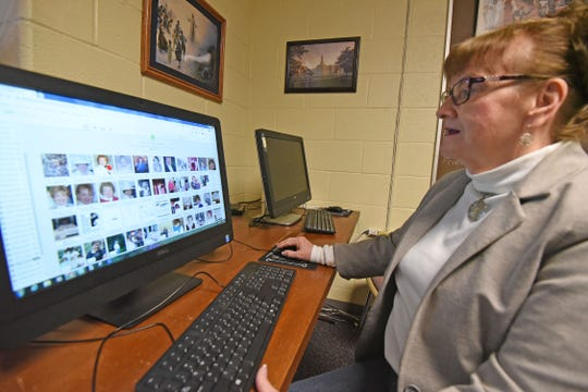 Peggy Clemens Lauritzen uses a computer at the  Jesus Christ of Latter-day Saints Church building to research genealogy.