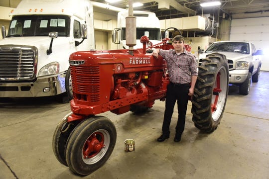 Dylan Finnegan, a senior from Shelby, refinished his family's 1941 Farmall H and presented it as his senior project at Pioneer Career and Technology Center.