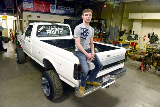 Carter Nelson, a senior at Pioneer who is from the Crestview Local School District, shows off the 1995 F-350 he restored for his senior project.