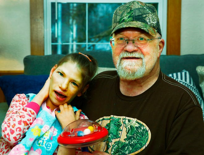 Megan Hess sits with neighbor Toby McClure. Noelle Bye, Times-Gazette.com