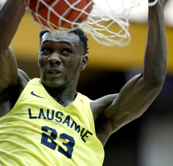 Lausanne's Moussa Cisse (23) dunks the ball Thursday, March 5, 2020, during the TSSAA Division II State Basketball Championship semifinal against Knoxville Webb at Lipscomb University's Allen Arena in Nashville.