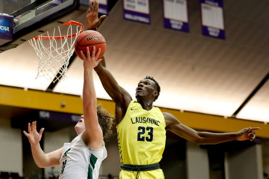 Lausanne's Moussa Cisse (23) blocks a shot by Knoxville Webb's David Sanger (11) on Thursday, March 5, 2020, during the TSSAA Division II State Basketball Championship semifinal at Lipscomb University's Allen Arena in Nashville.