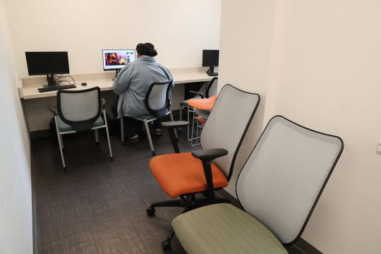 Several computers at St. Anthony's Place are available for use by residents in a common area.