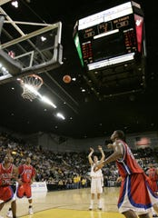 UW Milwaukee's Adrian Tigert sinks the game winning free throw against the Detroit Titans in the Horizon League Basketball title game, giving the Panthers an NCAA berth Tuesday, March 8, 2005.