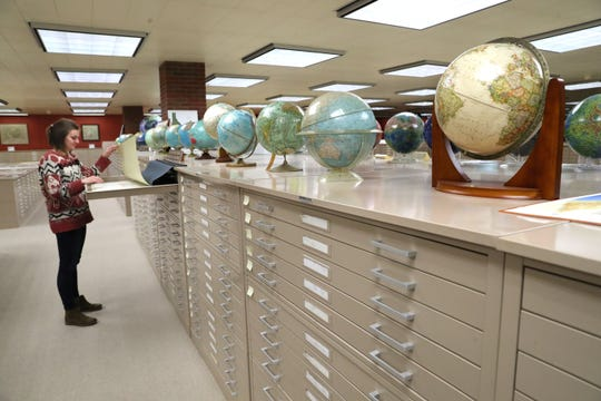 Georgia Brown, a UWM graduate student getting her master's degrees in history and library science, works Thursday in the American Geographical Society Library on campus. Because of declining enrollment, the university this week offered voluntary buyouts to employees.